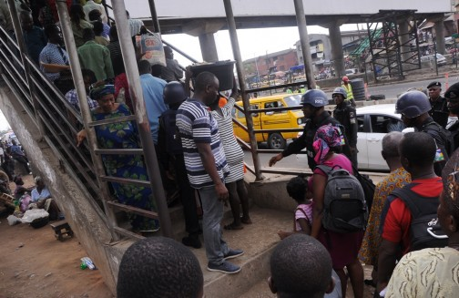 Commander, Rapid Response Squad, ACP Tunji Disu, leading his team to maintain peace and order on the usage of the Ojota Pedestrian Bridge, Lagos on Monday, April 11, 2016