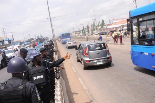 Commander, Rapid Response Squad, ACP Tunji Disu and his team ensuring free flow of traffic at Mile 12, Ikorodu Road, Lagos on Monday, April 11, 2016.