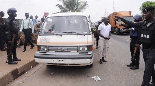 A Bus Driver being apprehended by men of the Rapid Response Squad (RRS) for picking passengers at undesignated bus stop at Ketu, Ikorodu Road, Lagos on Monday, April 11, 2016
