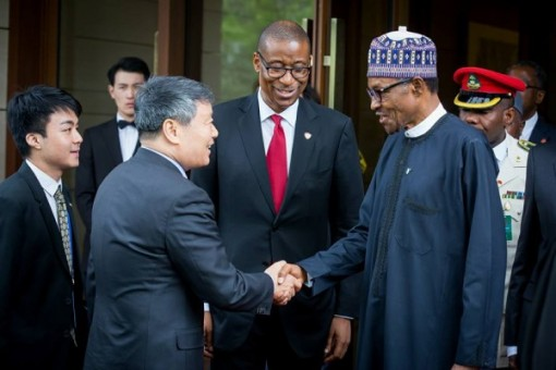 President Buhari being welcomed by Mr Xu Shaoshi Chairman of National Reform and Development Commission. With them is Minister of Industry, Trade & Investment Okechukwu Enemalah