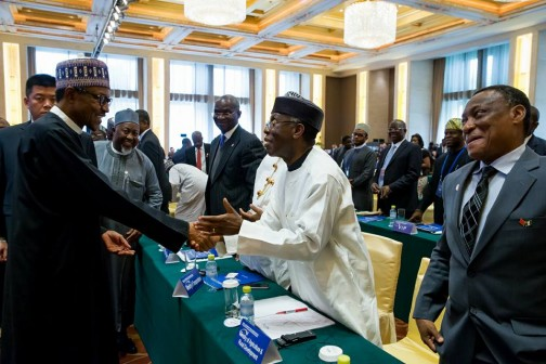 Buhari in a handshake with Agric Minister, Audu Ogbeh. With them is Raji Fashola, Minister of Works, Housing and Energy