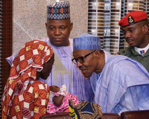 Buhari receives rescued Chibok schoolgirl