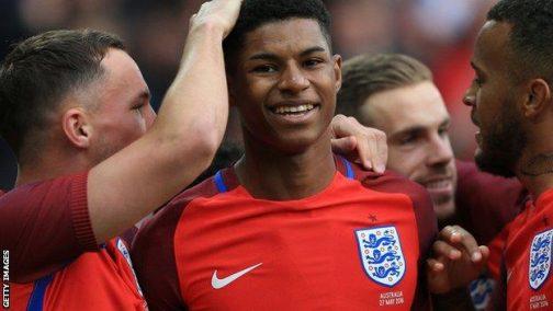 Marcus Rashford celebrates after scoring on England debut