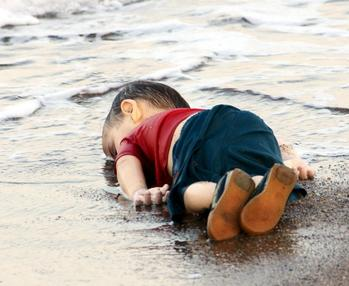The photograph of Alan_Kurdi_lifeless_body after being washed ashore stirred the world's conscience to the migrant crisis