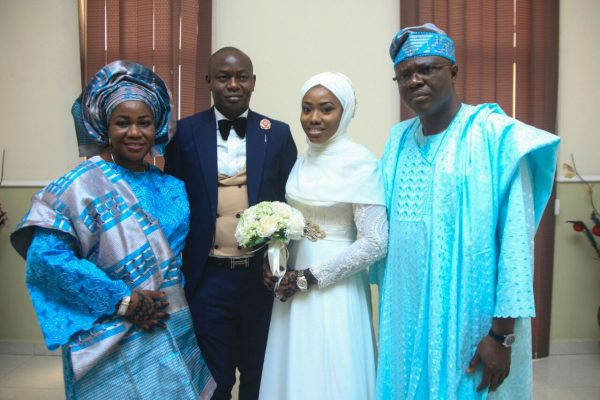 The Huthmans with the parents of the bride, Mr Bimbola Onisabi and the wife
