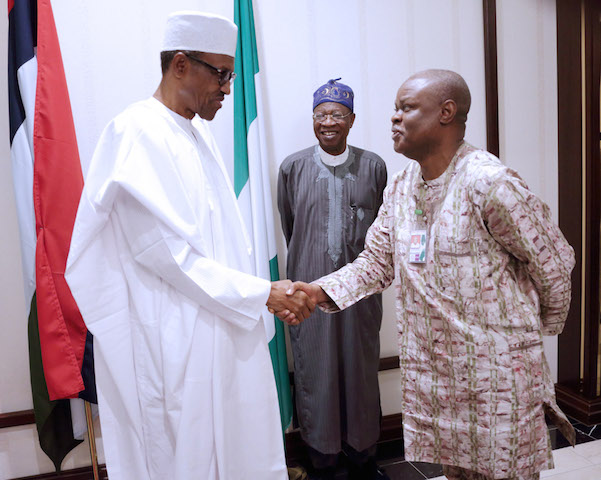 President Muhammadu Buhari in a handshake with Mr. Justin Abuah, Director Information, State House during the breaking of Ramadan Fast with State House Press Corps at the Villa.