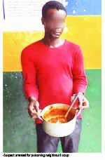 The suspect holding the pot of soup