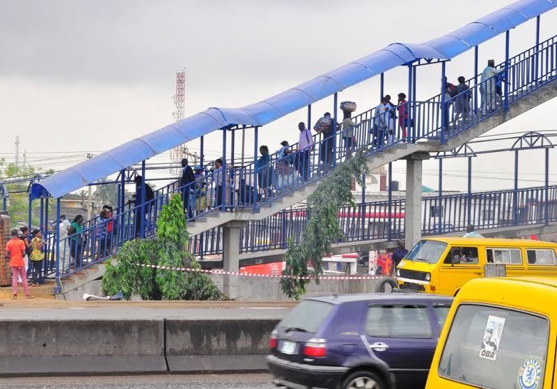 Lagosians using the completed Pedestrian bridge at Berger, Lagos.