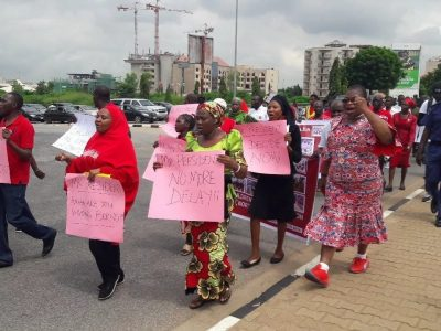 Members of #BringBackOurGirls marching to Aso Rock before they were stopped