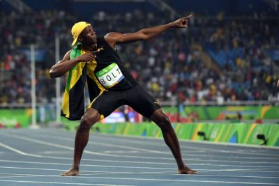 Usain Bolt (JAM) celebrates after winning the men's 100.