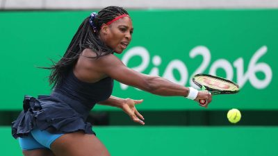 Serena struggling to contain her opponent during the match