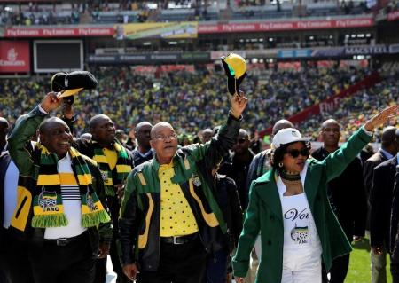 ANC president Zuma waves to his supporters next to his deputy, Ramaphosa as they arrive for the parties traditional Siyanqoba rally ahead of the local municipal elections in Johannesburg
