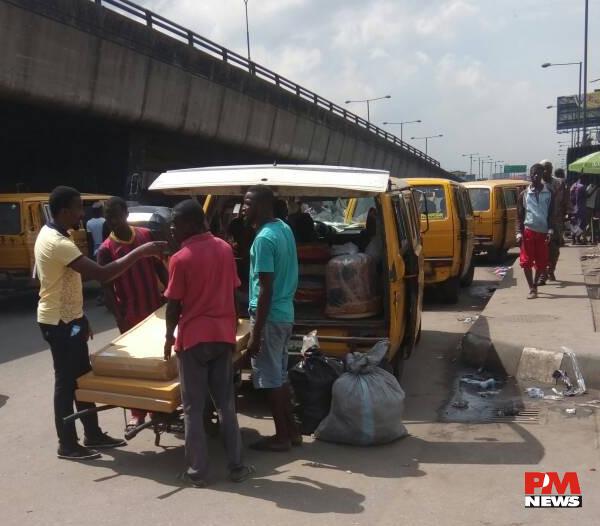 Bus loading at Ojuelegba Bridge, Lagos