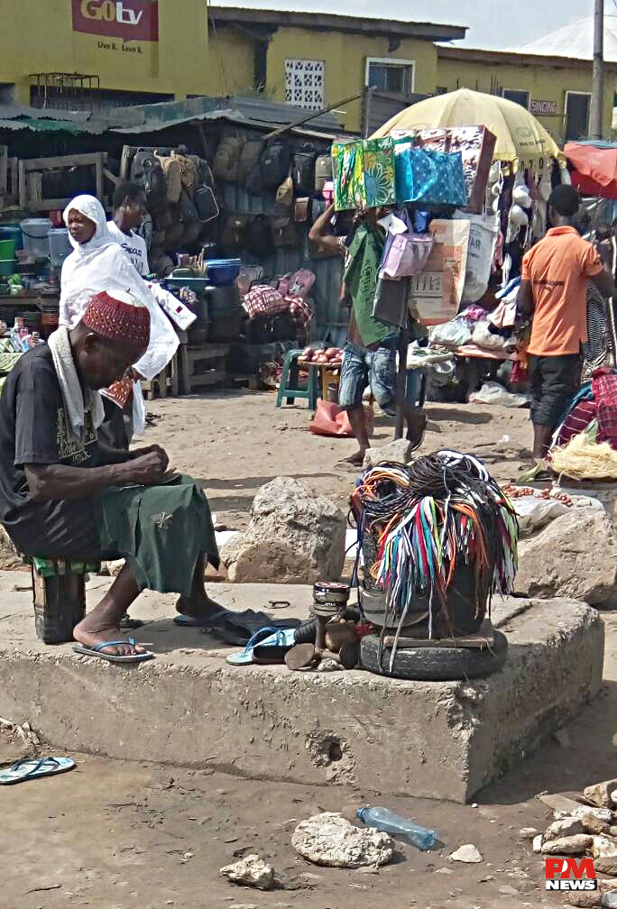 We are always willing to fix your shoes at Oshodi Market.