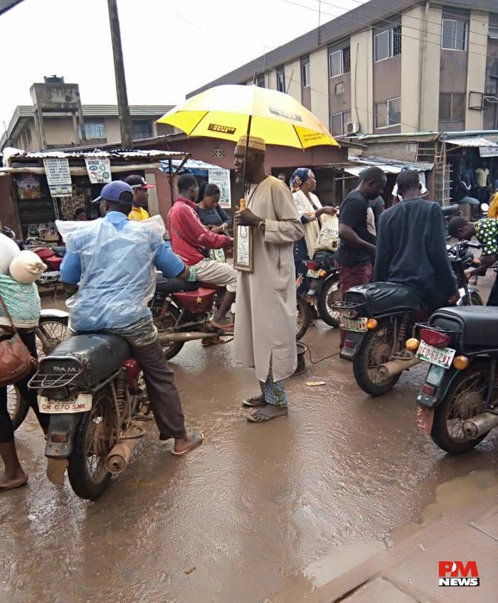 Ile-Epo bike men undeterred despite the rain.