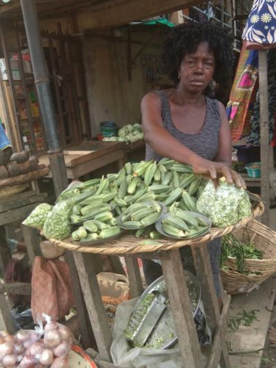 Mama Amaka selling Okro at Bariga Market.