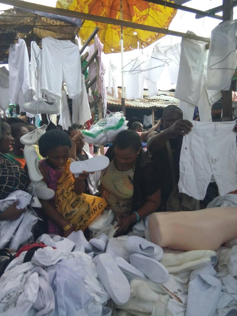 Prospective corporate members buying NYSC kit at Katanguwa Market.