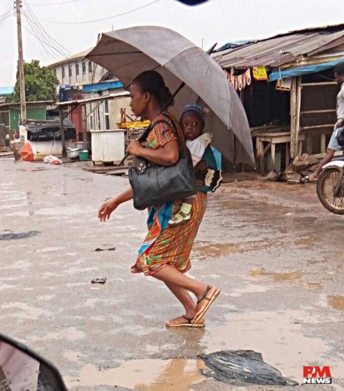 rain woman and child