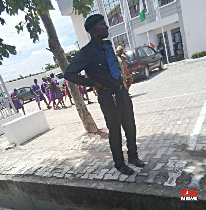 Security man on duty at Okota Isolo