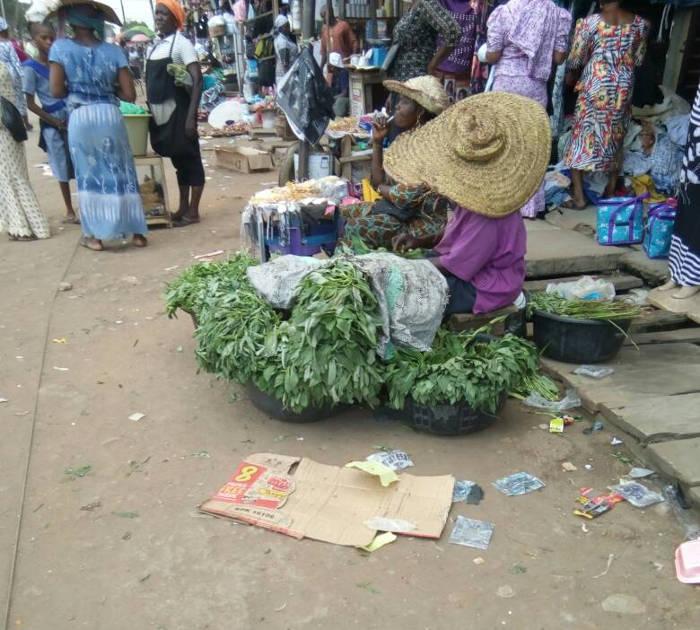 Vegetable seller displaying her wares at Iyana Ipaja Market.