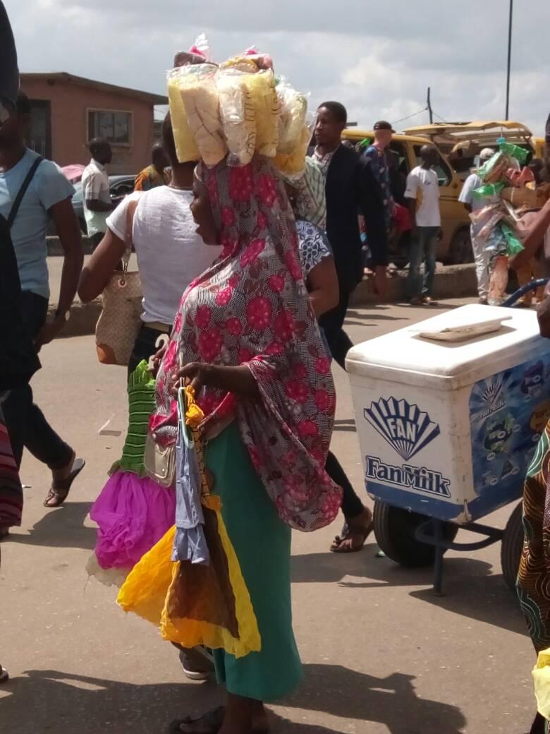 Woman hawking scarves at Iyana Ipaja Market