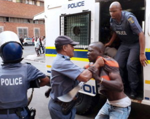 south african police beats nigerian to death