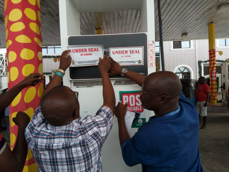 DPR officials sealing petrol station in Warri – photo NAN