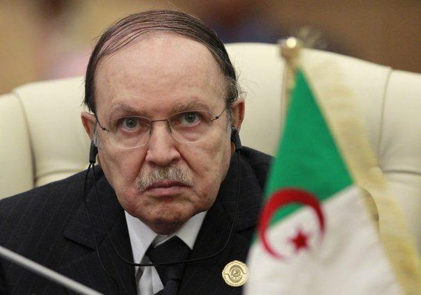 Algeria's President Bouteflika listens to speech of Libya's leader Gaddafi at the start of the third EU-Africa summit in Tripoli