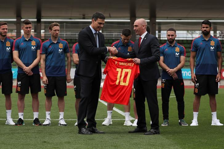 Spain's new PM Sanchez receives a Spanish national soccer jersey with his name while he poses with the Spanish team at the Spanish Federation Soccer Headquarters in Las Rozas