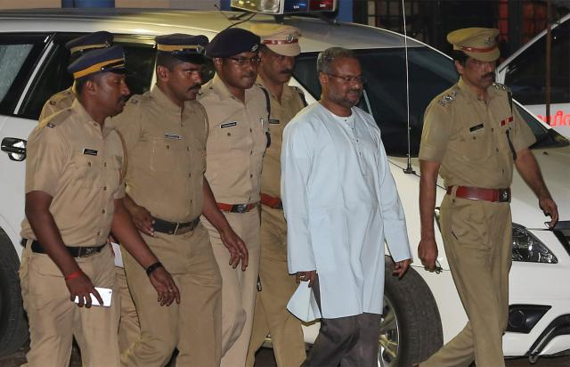 Bishop Franco Mulakkal, accused of raping a nun, is escorted by police outside a crime branch office on the outskirts of Kochi in the southern state of Kerala