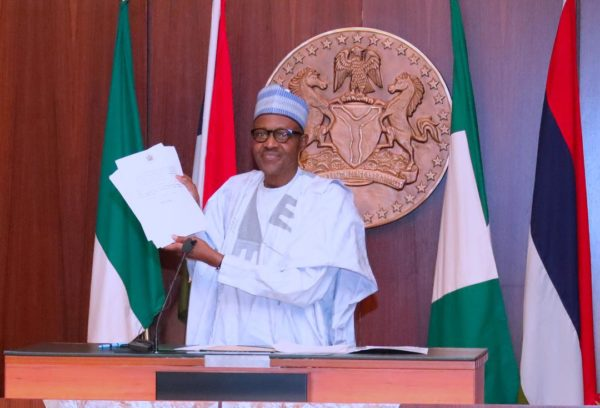 Buhari-shows-the-executive-order-on-assets-forfeiture-just-signed-today-e1530814945278
