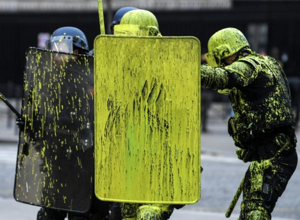 Protesters-haul-paint-against-the-police-e1543666822683