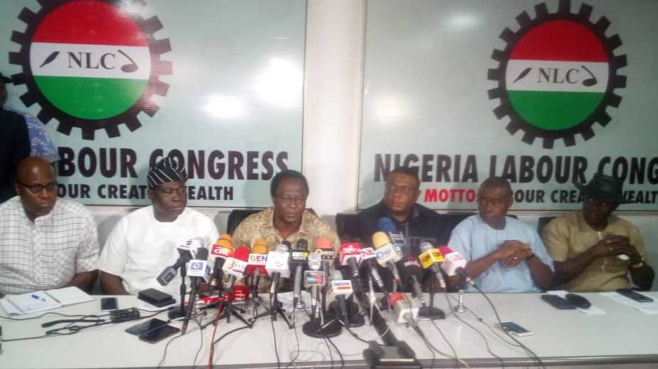 NLC-President-Ayuba-Wabba-middle-adressing-a-world-press-conference-at-its-headquarters-on-suspension-of-warning-strike-on-new-national-minimum-wage