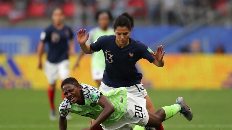 Gritty  match: A Super Falcons player and a French player