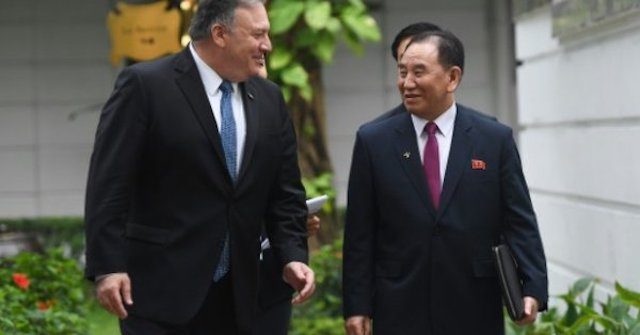 Kim Yong Chol, right, falsely reported to have been purged with Mike Pompeo