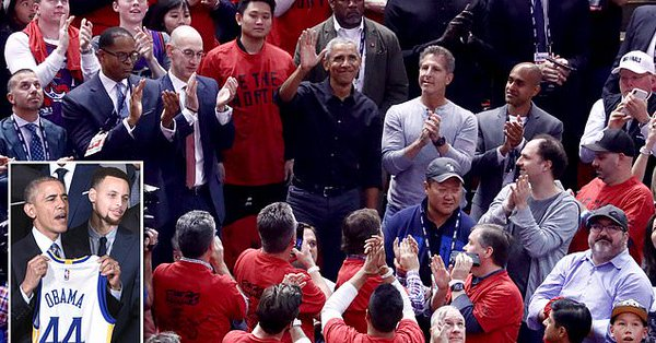 Obama, middle acknowleding cheers during the Raptors-Warriors Game 2