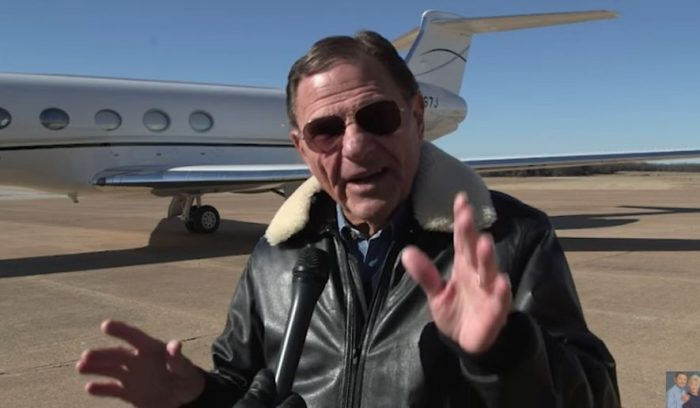 Pastor Kenneth Copeland with one of his jets