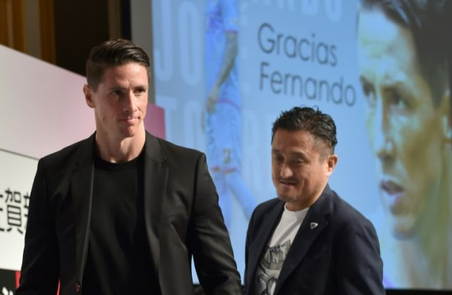 Sagan Tosu forward Fernando Torres (L) and Minoru Takehara (R), president of the J-League football club Sagan Tosu