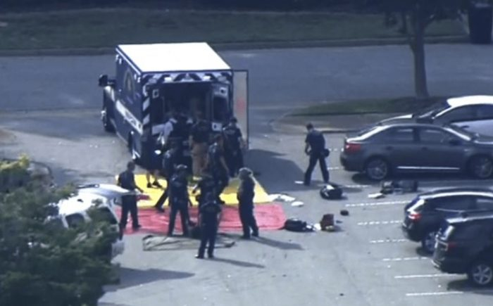 Victims of Virginia Beach shooting being loaded in a police vehicle