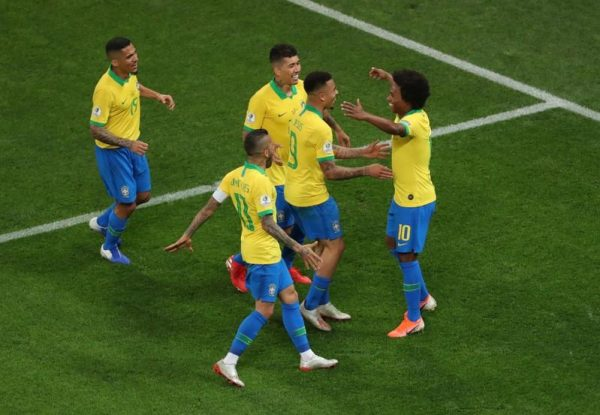 Willian being congratulated by team mates
