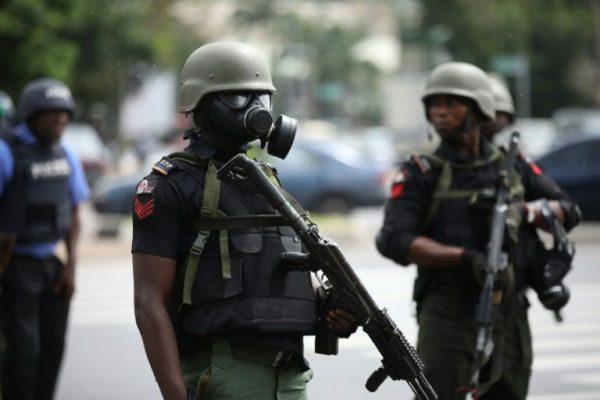 A Nigerian policeman in riot gear