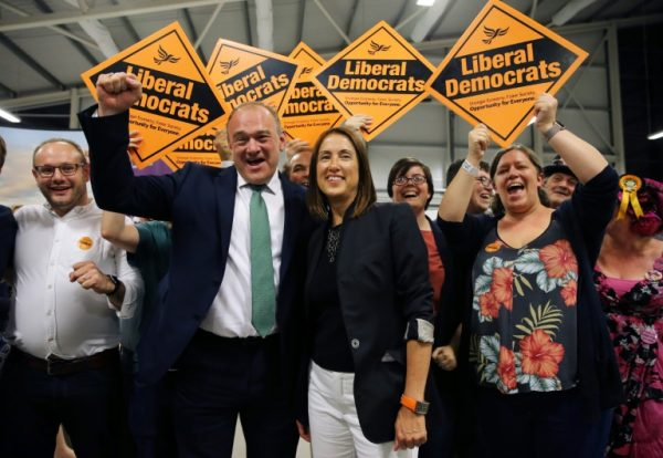 Liberal Democrat candidate Jane Dodds celebrates as Conservative candidate kissses the dust