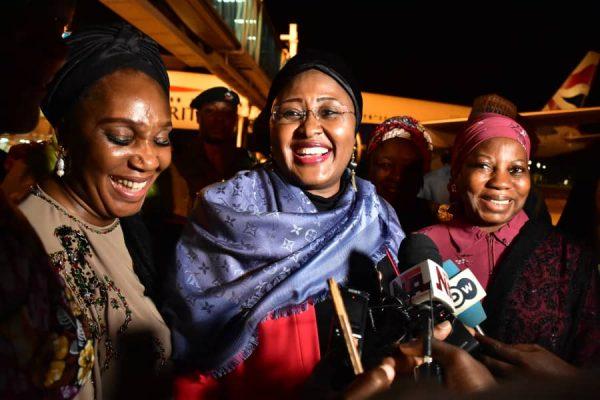 Aisha Buhari flanked by aides