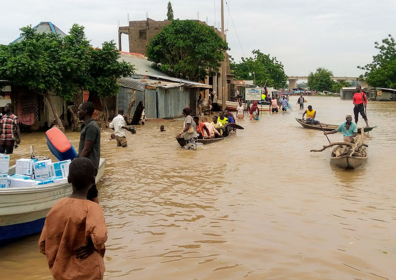 Pic.-7.-People-using-canoe-for-movement-due-to-flood-in-Adamawa