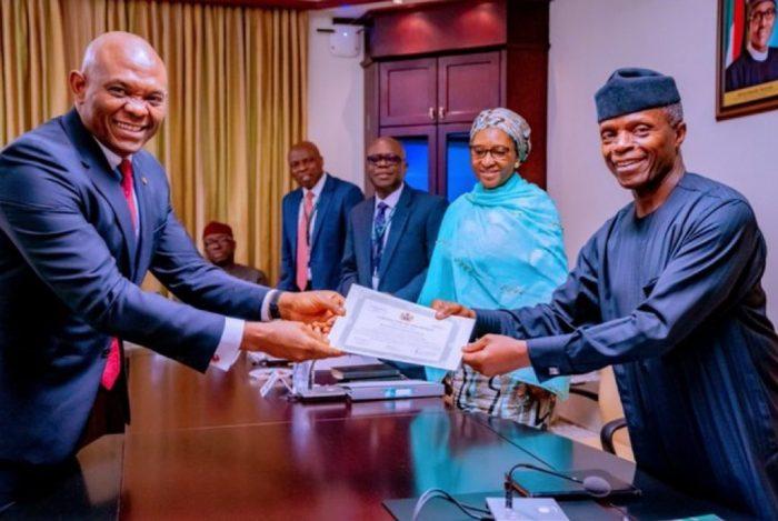 VP Osinbajo presents certificate of discharge to Tony Elumelu, Chairman of Transcorp