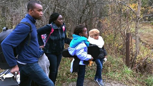 A Nigerian family trying to cross into Canada at Roxham Crossing