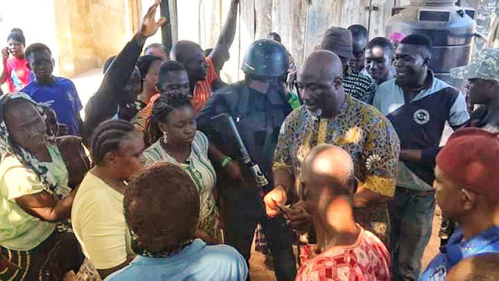 Dino Melaye sharing money at polling booth on Saturday