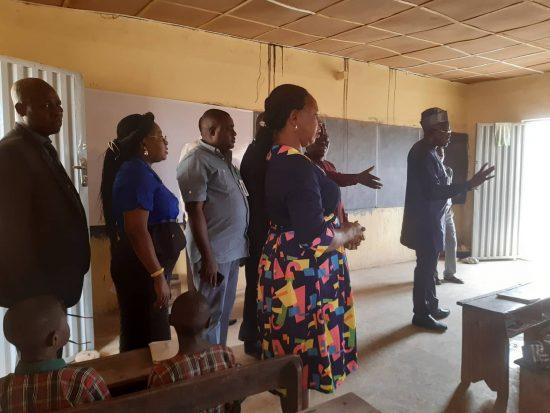 Dr. Nureni Adeniran addressing primary school pupils in a classroom