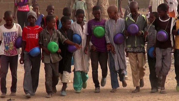 Almajiri children setting out to beg for food. They are a creation of northern elite