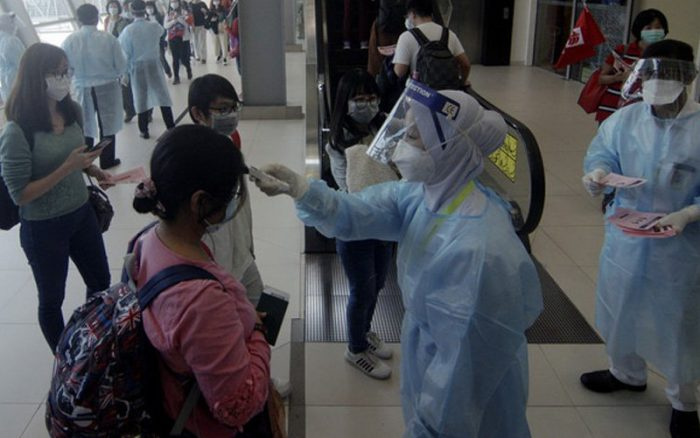 Travellers being tested at the Malaysia airport on arrival
